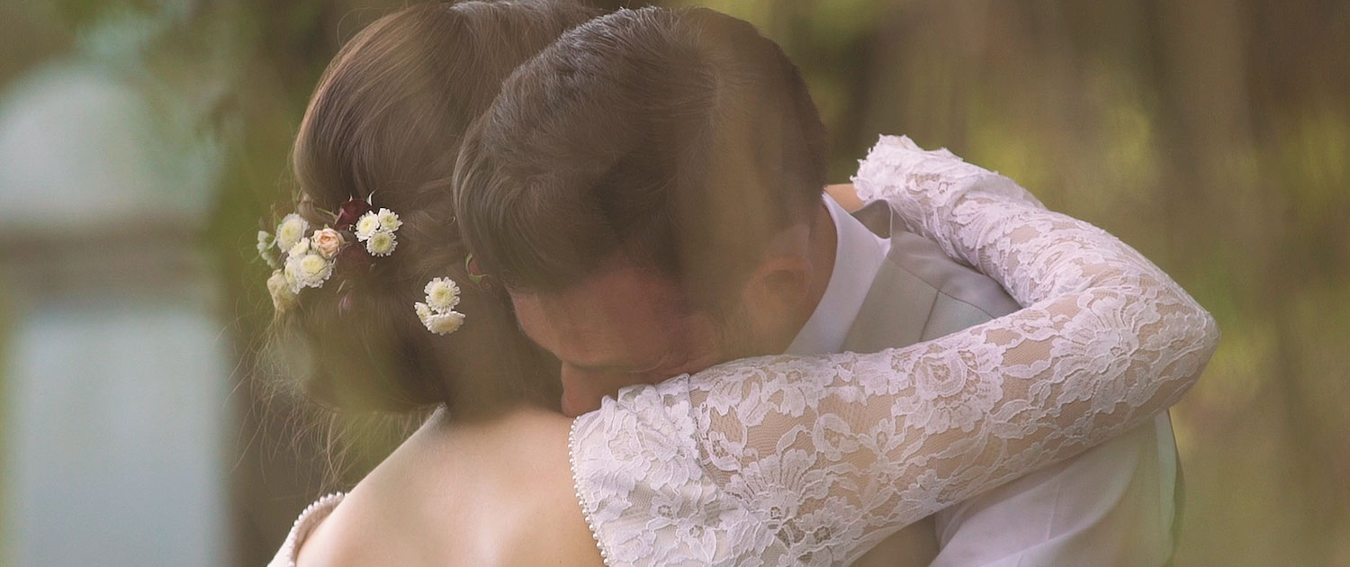 Luxury wedding film - Bride and Groom Hugging